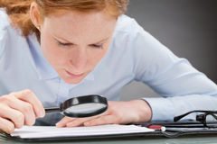 Careful Businesswoman Analyzing Contract Royalty Free Stock Photos