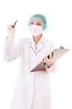 Careful doctor with pen looks up Stock Photo