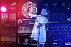 Careful girl looking at the screen and creating a program Royalty Free Stock Images