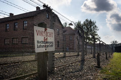 Careful, High-Voltage, Danger sign in Auschwitz II-Birkenau camp in Brzezinka Stock Photo