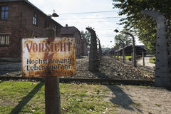 Careful, High-Voltage, Danger sign in Auschwitz II-Birkenau camp in Brzezinka Stock Image