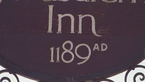 The careful letterings of an inn`s outdoor signage