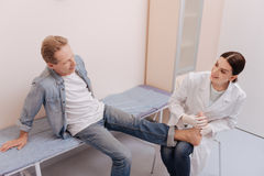 Careful prominent doctor asking patient what he feeling Royalty Free Stock Images