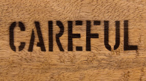 Careful on wood. Text careful on wood texture surface for notice Royalty Free Stock Images