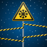 Carefully cold. Warning sign safety. pillar with sign and warning bands. Vector Image. Stock Images