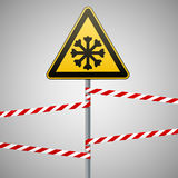 Carefully cold. Warning sign safety. pillar with sign and warning bands. Vector Image. Stock Photos