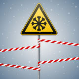 Carefully cold. Warning sign safety. pillar with sign and warning bands. Vector Image. Royalty Free Stock Images