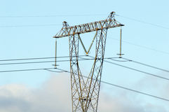 Carefully high voltage. Overhead line poles with wires against the sky Stock Image