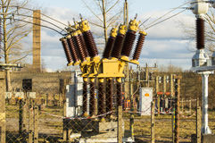 Carefully high voltage. Powerful electrical insulators at the station Royalty Free Stock Photography