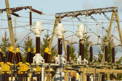 Carefully high voltage. Powerful electrical insulators at the station Stock Photos
