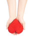 Carefully holding heart with two hands Royalty Free Stock Photos