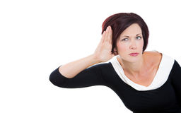 Carefully listening, nosy business woman with hand to ear Royalty Free Stock Photos