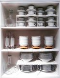 Ð¡rockery in the buffet. Carefully placed dishes in a white cupboard royalty free stock photography
