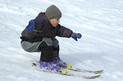 Carefully skier. Young boy skiing cerefully down Royalty Free Stock Photo