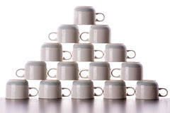 Carefully stacked pyramid of drying coffee cups Stock Photo