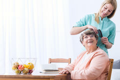 Caregive take care of patient. Image of caregiver take care of senior patient Stock Photography