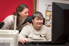Free Caregiver And Mentally Disabled Woman Learning At The Computer Stock Photo - 85104650