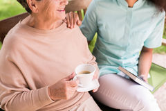 Caregiver caring about female pensioner Royalty Free Stock Images