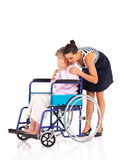 Caregiver comforting senior woman Stock Photos