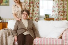 Caregiver comforting senior woman Royalty Free Stock Image