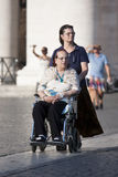 Caregiver and disabled lady Royalty Free Stock Image