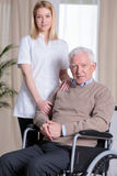Caregiver and disabled man Royalty Free Stock Image