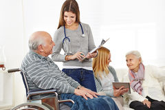 Caregiver doing survey with senior Royalty Free Stock Images