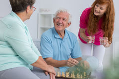 Caregiver and elderly couple Royalty Free Stock Photography
