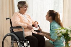 Caregiver helping old female Royalty Free Stock Photo
