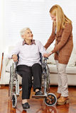 Caregiver helping senior woman Stock Images