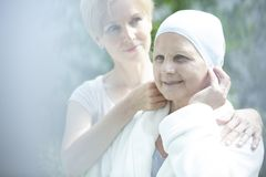 Caregiver helping sick woman with cancer royalty free stock photo