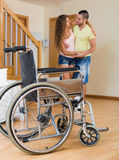 Caregiver helps handicapped girl Royalty Free Stock Photos