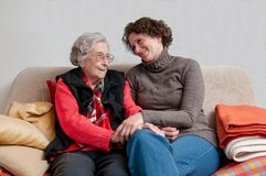 Caregiver holding hand of senior woman royalty free stock photos