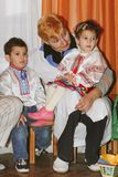 Caregiver and little orphan children Stock Photos