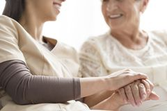 Caregiver in the nursing home. Close-up of person touching hand of senior woman. Caregiver in the nursing home stock photos