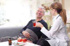 Caregiver and old patient Royalty Free Stock Image