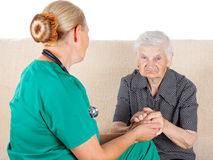 Caregiver and patient Stock Images
