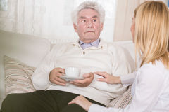 Caregiver and retired man Stock Photography