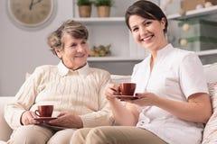 Caregiver and senior female Stock Images