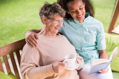 Caregiver and senior in garden royalty free stock images
