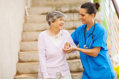 Caregiver senior stairs Stock Photo