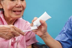 Free Caregiver Take Care Elderly Woman While Using Toothbrush Stock Photo - 189897320