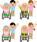 Caregiver and the wheelchair of the elderly Stock Image