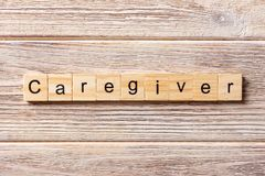Caregiver word written on wood block. Caregiver text on table, concept royalty free stock images
