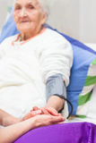 Caregiving for the ill ones Stock Images