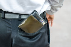 Careless man with wallet falling back pocket. Risk of theft. Closeup. Careless man with wallet falling back pocket. Risk of theft Stock Images