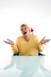 Careless man wearing christmas hat. In an office Stock Photography