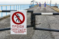 Tourists ignore taboo to walking on emergency pier. Careless tourists ignore the forbiddance on walking on the emergency pier Royalty Free Stock Photos