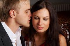 Careless whisper. Between man and woman Stock Photos