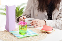 The careless woman at the cafe. The careless women is sitting at cafe with purse on the table Royalty Free Stock Photography